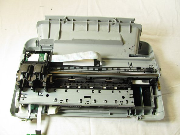 Gently push the ink cartridge carriage to the left side of the printer.