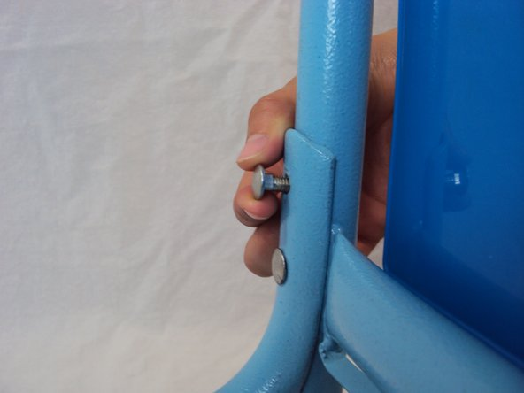 Image 2/3: Attach the crossbar to the frame using four [4] frame nuts and bolts.