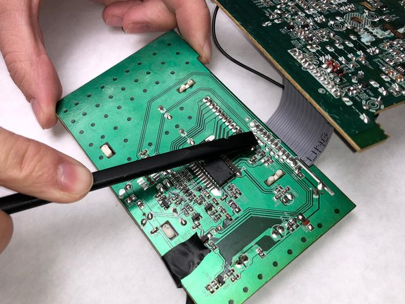 Heat the solder around the pins with a soldering iron so the pins can be removed and the screen can be detached. Use a flat object to help push out the pins.