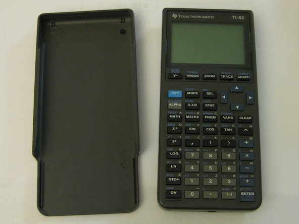 The calculator comes with a matching protective shield which slides down over the front; when the calculator is in use, you can slide it over the back.  This is a nice touch, as it makes the cover much more difficult to lose.