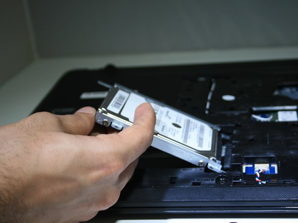 Slide the hard drive over and remove it from the device.