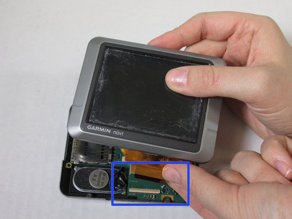 This detaches the motherboard and LCD Screen (see second picture for blue box).