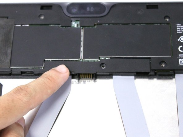 Slide the cover on the two middle ribbon cables out to remove it. It should uncover the orange cable connectors.