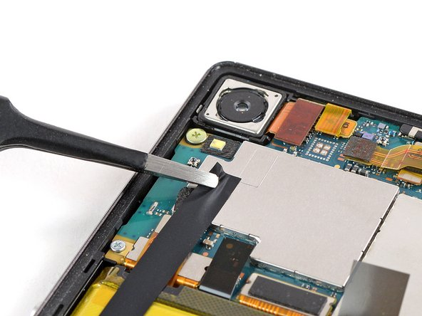 Use a pair of tweezers to carefully peel the adhesive strip off the mother board and the battery and remove it.