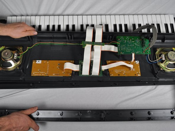 Flip the top half of the keyboard and set onto the bottom half with the internal parts facing up.