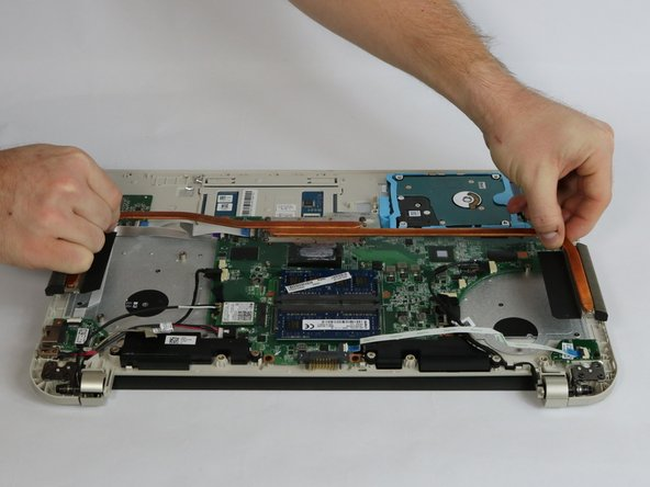 Gently lift on either side of the heat sink to separate it from the laptop.