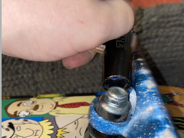 After the kingpin nut is secured, take your T-Tool and add the wheels back onto and secure them in place.