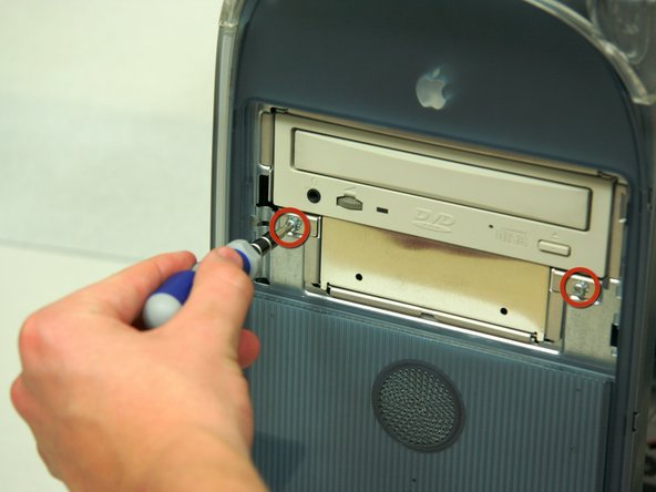 Remove the two screws on the front of the drive with the Phillips #1 screwdriver.