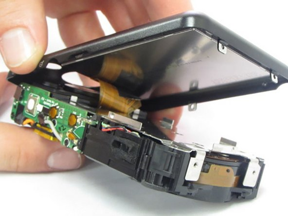The last part of the casing to disconnect is the back that houses the LCD screen.