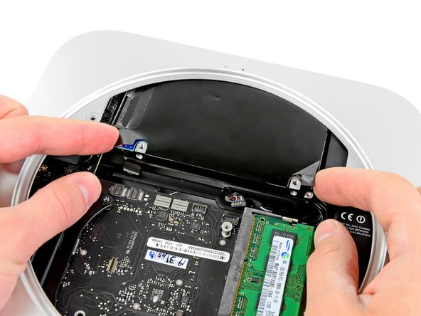 Pull the hard drive away from the front edge of the mini and remove it from the outer case.