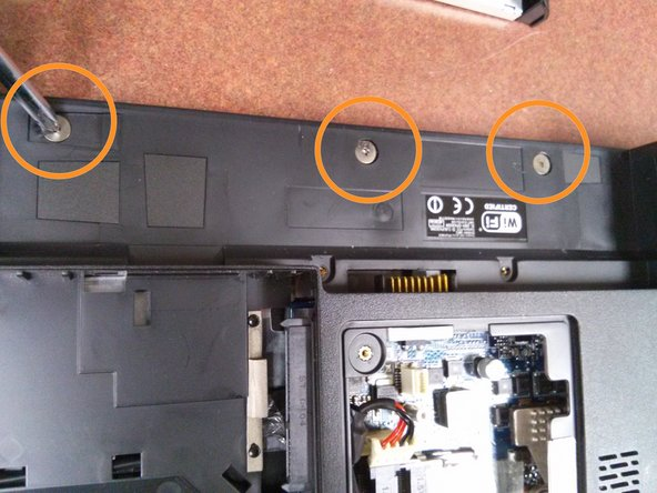 Image 1/3: There are two more screws, one on each side of the battery connection that also need removed.