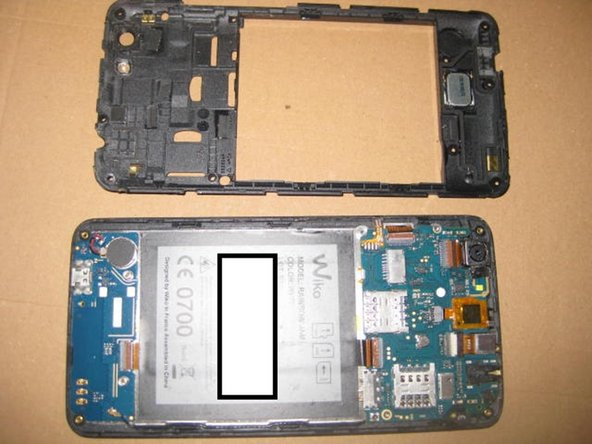 once the connector is secured, replace the back frame back onto the phone