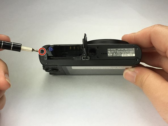 Remove 1 black Phillps 4 mm screw using a Ph000 screwdriver tip from under battery cover.