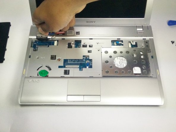 Pull up and away from device to detach the LCD ribbon cable.