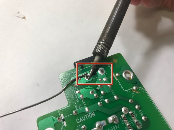 Image 1/1: Re-solder the new input jack component onto the daughterboard.
