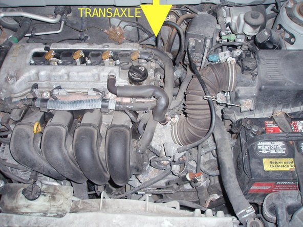 Transaxle is behind and below engine.  You will have a hard time seeing it if your height is less than 170 cm.  If you are two metres tall or taller, then it will be easy to see.