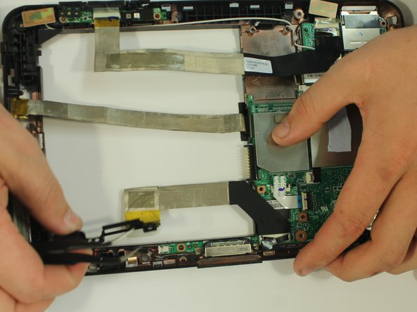 Using a pair of tweezers, remove the speaker.