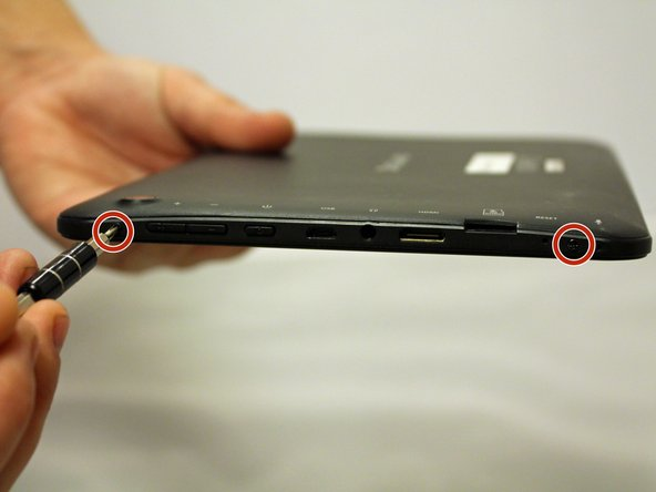 With a J00 Philips head screwdriver, unscrew the two 4mm black screws  located at the bottom of the device.