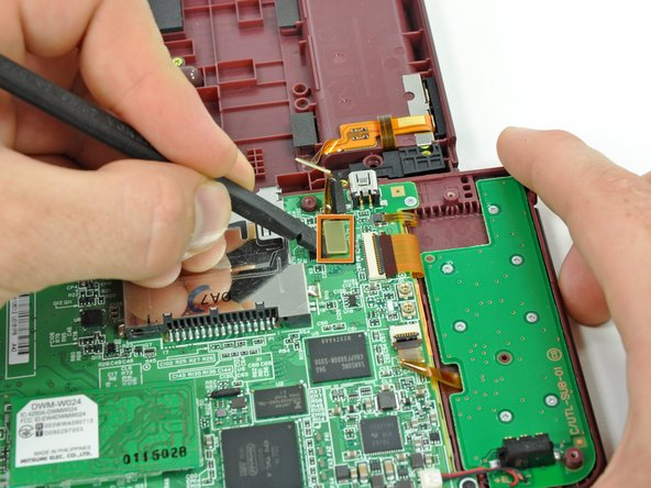 Image 2/2: Pry the volume button/left shoulder button connector off its socket on the motherboard with a spudger.