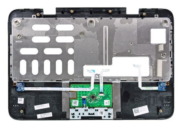 On the underside of the upper case, we see the touchpad,  and the two switches we suspected before.