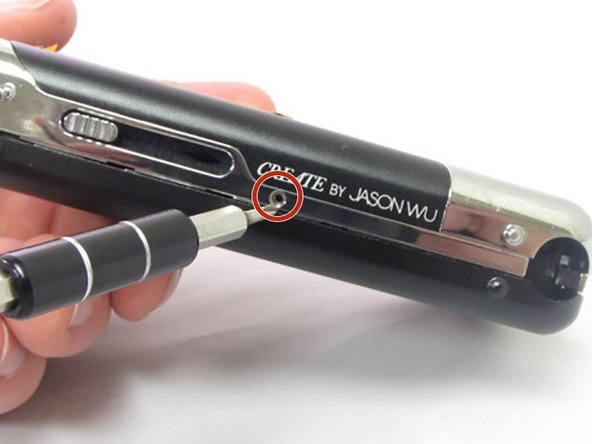 Begin by removing the 5 screws (located: 2 screws on either side and 1 screw on the bottom) using the PH000 head in the Precision Phillips Screwdriver.