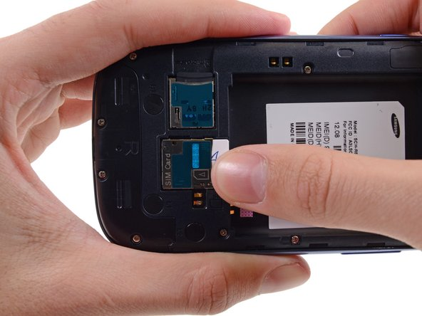 Image 1/3: Grasp and remove the SIM card away from the phone.