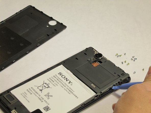To remove the internal cover, use the plastic spudger tool and pry the cover from the phone as shown in the picture.