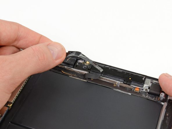 Peel back and remove the adhesive tape covering the headphone jack assembly.