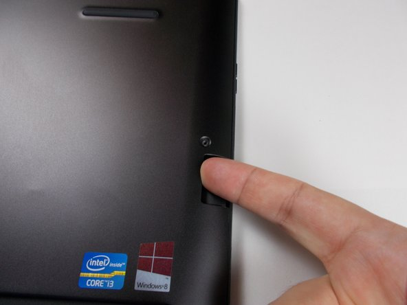 There is a door on the right side that pushes in to allow access to the SD card port. This is a perfect place to insert your finger to get a good hold on the back panel. Use a finger to pull straight away from the unit to lift off the rear panel. It may stick a little but it will pull right off easily.