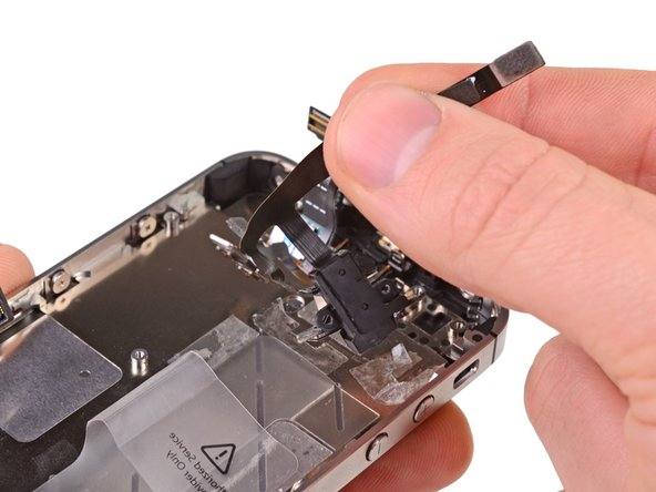Image 1/1: Remove the headphone jack cable assembly from the iPhone.