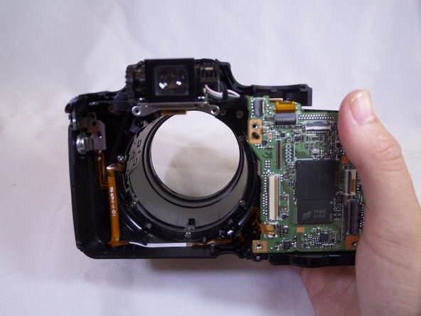 Be careful not to damage any of the electrical ribbon on top of the lens.