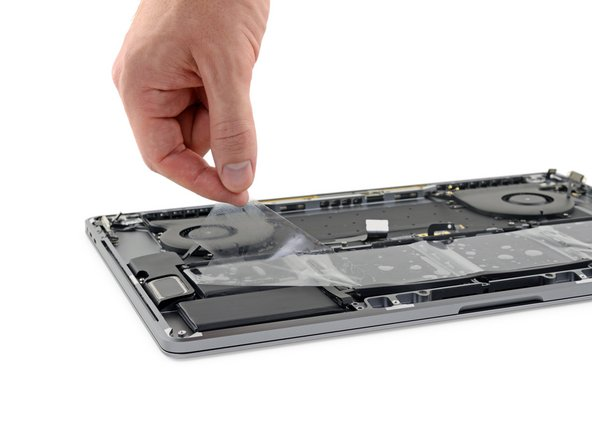 After your battery is properly positioned and installed, peel off and discard the clear plastic liner from the top.