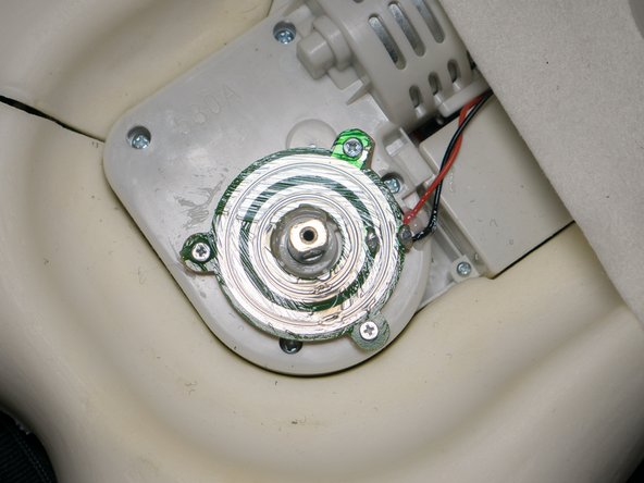 You can see a green circuit board after removing the heater.