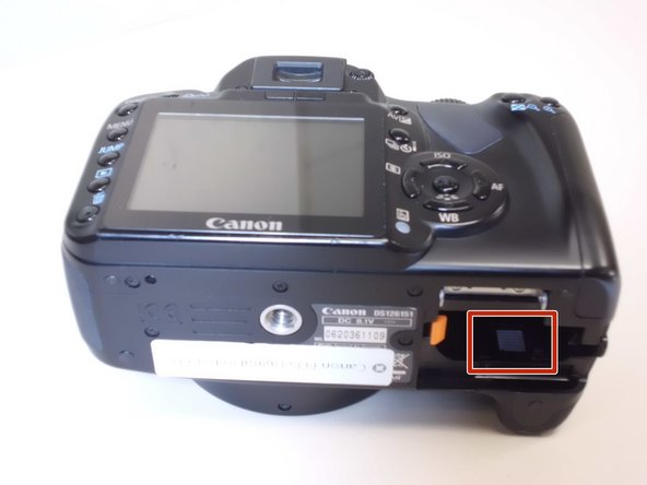 To remove the secondary battery, reposition the camera to where the display screen is facing upwards.