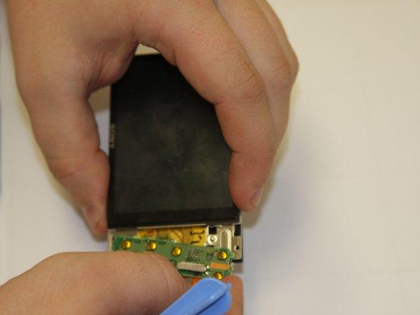 Remove the button circuit board.