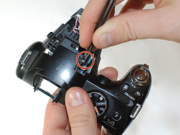 Use a pair of tweezers to remove the flash mechanism springs , then replace with the new springs.