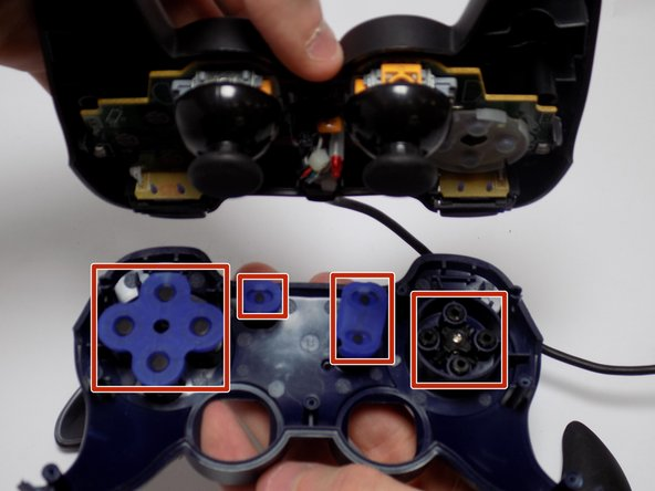 There should be 4 circular buttons labeled 1-4, 4 smaller circular buttons for the D-Pad, and 3 oval shaped buttons.