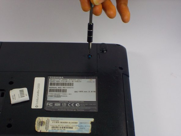 Remove the one 5.0mm Philips #0 screw that holds down the panel covering the hard drive.