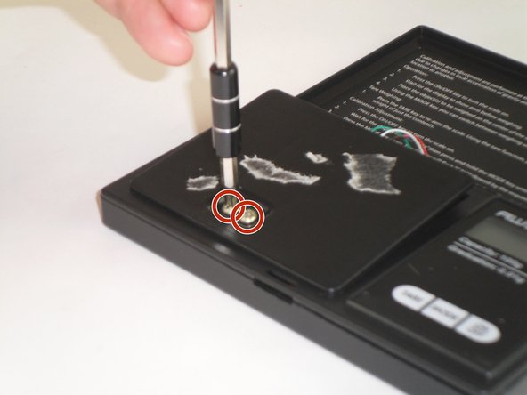 """Using the same screwdriver as before, remove the two screws (length 3/8"""") on the plastic plate connected the sensor."""