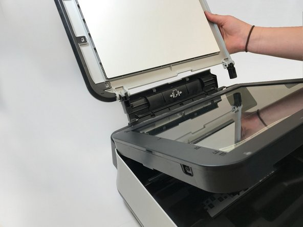 The first thing you do is take off the top cover of the printer. After opening the snap fits, the top cover can be slid off easily.