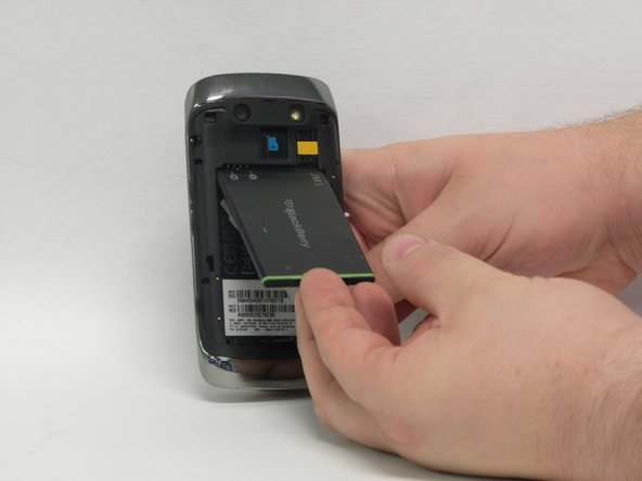 Once the plastic covering is removed, you can remove the battery.