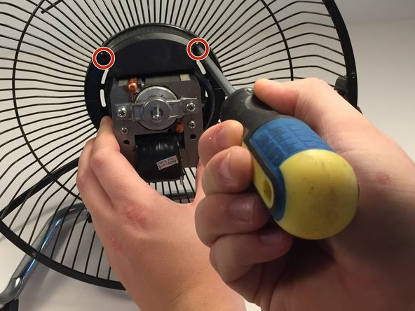 Remove the  wiring cover located above the fan motor.