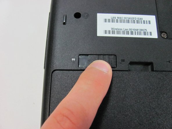 Image 3/3: The battery is unlocked when the battery lock switch is slid to the side with an image of an unlocked lock.