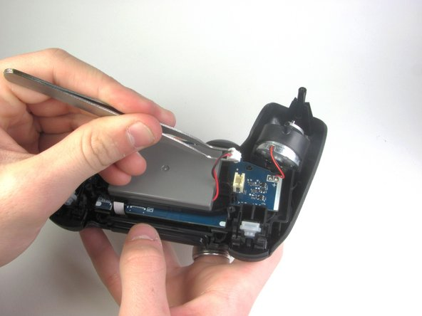 After removal of the plug from the motherboard, the battery can be lifted off of the controller.