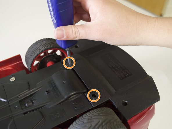 Remove the two 6 mm screws that connect the rear panel to the body of the car.