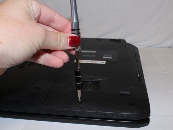 Remove the 5 (9 mm screws) around the outside edges of the back cover with the PH1 Phillips-head screwdriver.