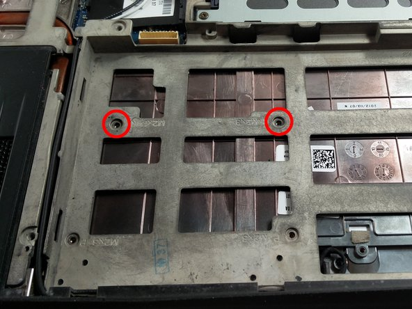 "Once the battery is removed, take out the two screws highlighted. For further identification, the frame engraves the name for the screw next to it's hole. These ones are named ""M2x3 K""."