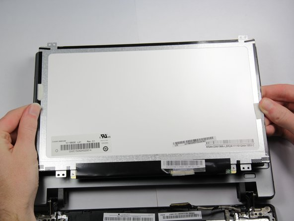 Image 2/3: Remove any remaining tape holding the screen to the laptop.