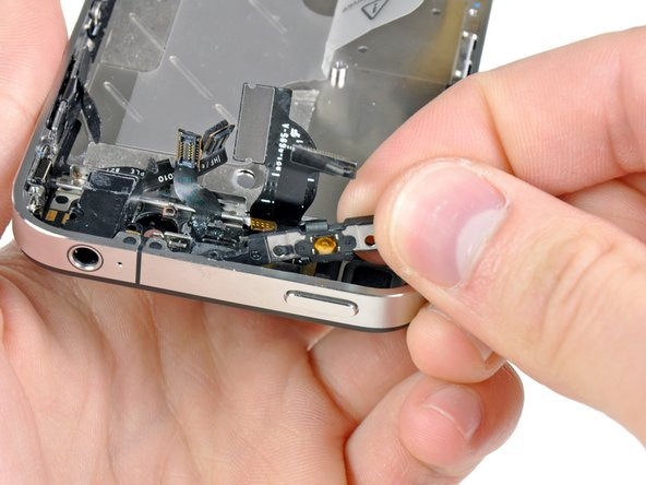 Carefully lift the power button bracket out of the outer case, minding its thin and delicate ribbon cable.