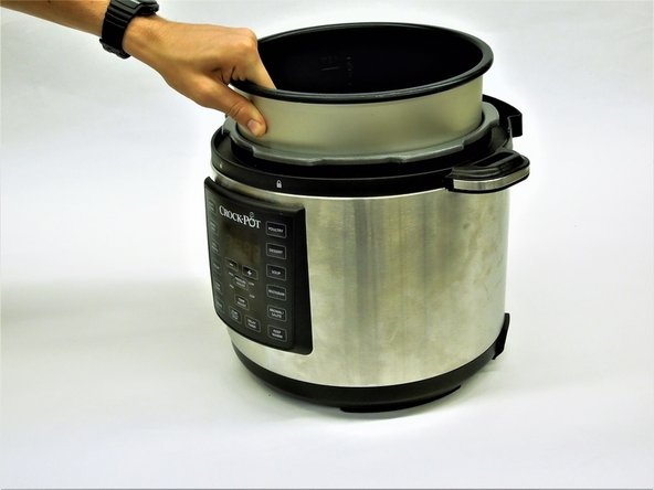 Remove the inner pot and set it aside for reassembly.